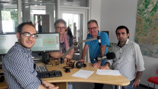 """Das Team von """"Refugee FM"""" bei Radio Wuppertal 107.4 – v.l.n.r. Delchad Heji, Katja Dummer, Georg Rose und Ahmad Idriss."""